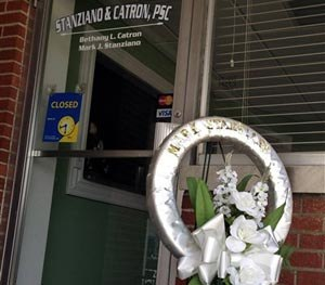 A memorial sits outside the office of defense attorney Mark Stanziano Friday morning, June 27, 2014, in Somerset, Ky. Somerset police say the 57-year-old Stanziano was shot and killed Friday morning outside his office.