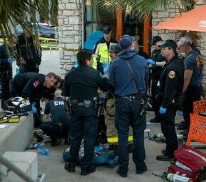 Police and paramedics respond to a stabbing at an Austin, Texas shopping plaza. (Photo/AP)