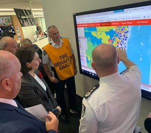 New South Wales Premier Gladys Berejiklian (in black, third from left) declared a state of emergency Monday due to dangerous bushfires raging across the Australian state since last week. (Photo/Gladys Berejiklian Twitter)