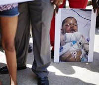 Family of Ga. toddler burned in raid want federal review
