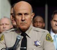 Former Calif. sheriff reports to prison