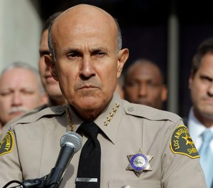Lee Baca has reported to prison to begin serving a three-year prison sentence for a corruption conviction, according to federal records. (Photo/AP)