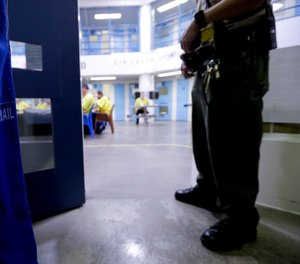 A Sheriff officer watches over inmates Thursday, April 27, 2017. (AP Photo/Chris Carlson)
