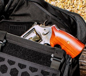 "The AMP 24 has a ""CCW pocket"" large enough to easily secret this 4"" barreled .44 magnum. (Photo/Warren Wilson)"