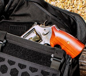 "The AMP 24 has a ""CCW pocket"" large enough to easily secret this 4"" barreled .44 magnum."