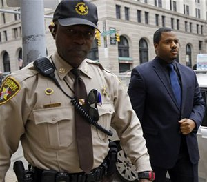 Officer William Porter, right, one of six Baltimore city police officers charged in connection to the death of Freddie Gray. (AP Image)