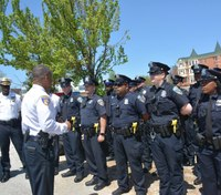 Baltimore police plainclothes units now in uniform, marked cars
