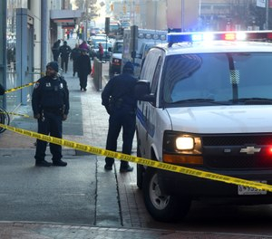 With just over 600,000 residents, the city hit a historically high homicide rate of about 57 per 100,000 people after a week of relentless gunfire saw eight people shot three fatally in one day and nine others one fatally another day. (Photo/Jerry Jackson/The Baltimore Sun/AP)