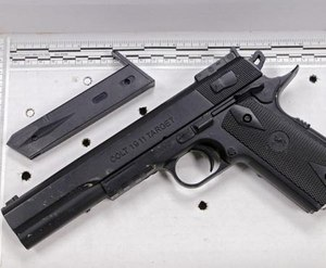 In this Nov. 26, 2014, file photo, a fake handgun resembling a Colt 1911 pistol, taken from Tamir Rice after he was fatally shot by Cleveland police, is displayed after a news conference in Cleveland.
