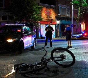 Baltimore Police investigate at a crime scene in Federal Hill where an officer was shot.