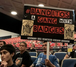 Community members speak out at a town hall in East Los Angeles on July 10, protesting the Los Angeles County Sheriff's Department's handling of the Banditos, an inked deputy group.