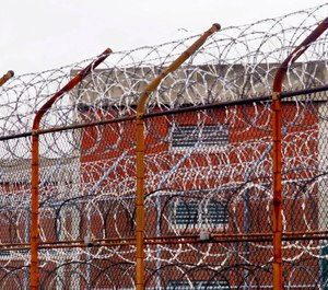 Rikers Island, where four corrections officers have been accused of watching before intervening in an inmate's attempt to hang himself. (Photo/AP)