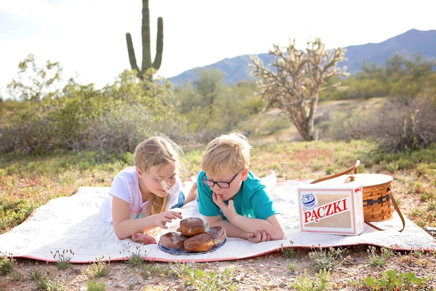 Rachel Barnes, 10, and brother Nathan, 8, in Arizona eat donuts shipped from Cops & Doughnuts of Clare, Michigan.