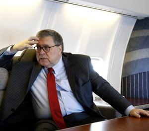 Attorney General William Barr speaks with an Associated Press reporter onboard an aircraft en route to Cleveland, Ohio. (Photo/AP)