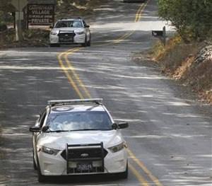 Three Pennsylvania State Police cars patrol along Snow Hill Road in Price Township, Pa, Tuesday, Sept. 30, 2014.