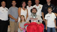 Boy, 10, becomes honorary firefighter after saving stepfather