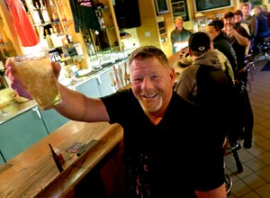 Marvin Radtke toasts the opening of the Friends and Neighbors bar following the Wisconsin Supreme Court's decision to strike down Gov. Tony Evers' safer-at-home order amid the coronavirus pandemic, Wednesday, May 13, 2020, in Appleton, Wis. Image: William Glasheen/The Post-Crescent via AP