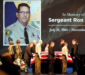 The flag draped casket of Ventura County Sheriff Sgt. Ron Helus arrives on stage for a memorial service for Sgt. Helus at Calvary Community Church in Westlake Village, Calif., Thursday, Nov. 15, 2018.
