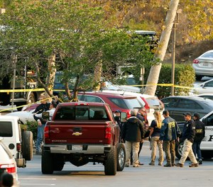 FBI investigators join law enforcement as they work near the scene of Wednesday's shooting in Thousand Oaks, Calif., Friday, Nov. 9, 2018. (AP Photo/Damian Dovarganes)