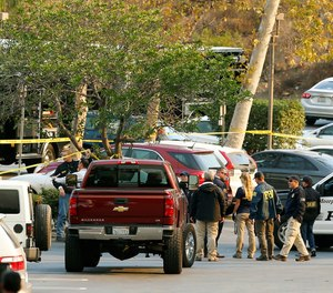 FBI investigators join law enforcement as they work near the scene of Wednesday's shooting in Thousand Oaks, Calif., Friday, Nov. 9, 2018.