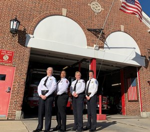 The four fire chiefs pose in front of the historic Catonsville, Maryland, Fire Station #4 (from left to right): Chiefs Rund, Green, Uhlhorn and Wolford.