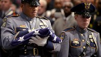 Ambushes prompt police families to ask, 'When is it going to stop?'