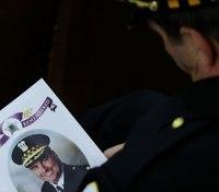 Family of slain Chicago police commander sues online gun dealer