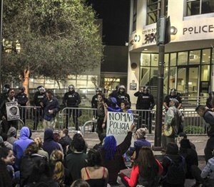 This Dec. 6, 2014 file photo shows demonstrators protesting in front of the Berkeley police station in Berkeley, Calif. (AP Image)