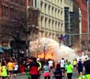 In this image from video provided by WBZ TV, a bomb explodes near the finish line of the Boston Marathon in Boston on Monday, April 15, 2013. (AP Image)