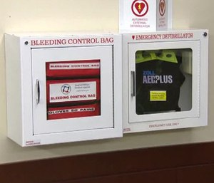 Wall-mounted stations (example above) each contain eight bleeding control kits, giving each school 24 smaller sets of tools. (Photo/Univ. of Wash.)