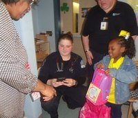 Medics surprise girl with birthday gifts after house fire