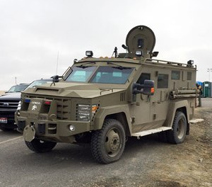 An armored vehicle known as a Bearcat blocks the road to the Malheur Wildlife Refuge at an FBI checkpoint outside of Burns, Ore., Friday, Feb. 12, 2016.