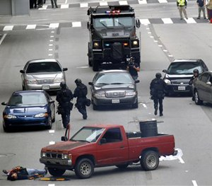 In this June 6, 2013 file photo, Los Angeles police take part in a downtown counterterrorism drill.