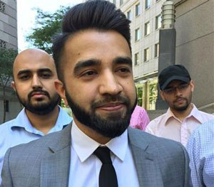 New York Police Department Officer Masood Syed, a practicing Muslim, center, leaves Manhattan federal court in New York Wednesday, June 22, 2016.