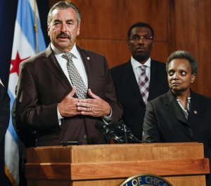 Superintendent Charlie Beck speaks to the media after Mayor Lori Lightfoot (right) announced him as the new interim superintendent on Nov. 8, 2019. (Photo/TNS)