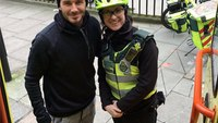 Soccer superstar David Beckham buys hot drinks for medic and patient