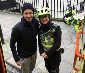 David Beckham poses with bike paramedic Catherine Maynard.