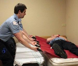 Patient moving technique using a flexible stretcher.
