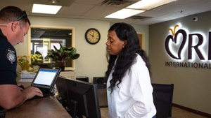 Behavioral health technician Ashanta Pleasant helps Peoria Police Department Officer Kevin Moe file paperwork for an involuntary admission at behavioral health center RI International in Peoria. Image: Mark Henle/The Arizona Republic