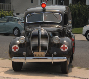 The 1938 Ford ambulance makes its last drive before heading to the Henry Ford Museum in Dearborn, Mich.