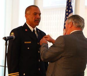 Orlando Fire Chief Benjamin M. Barksdale Jr. (left) was sworn in Monday and said his vision is to have a