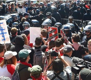Protesters confront San Francisco Police officers outside of Alamo Square Park in San Francisco, Saturday, Aug. 26, 2017. Officials took steps to prevent violence ahead of a planned news conference by a right-wing group.