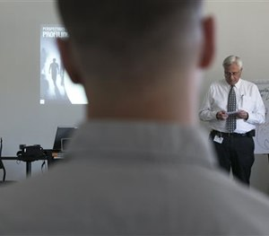 In this Feb. 11, 2015, photo, veteran LAPD officers Anne Bozzi, left, and Don Wynne, far right, instruct dozens of unidentified Los Angeles Police Department officers. (AP Image)