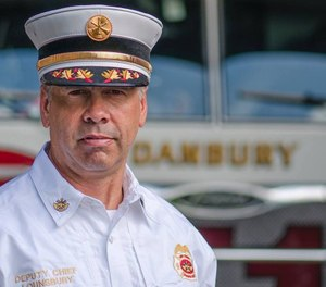 Danbury Fire Department Deputy Fire Chief Bill Lounsbury teamed up with a pediatrician to help a fellow airplane passenger who was having an anaphylactic reaction. (Photo/Danbury Fire Department Facebook)