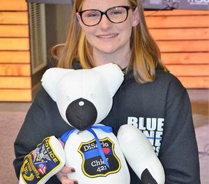 Megan O'Grady, 15, poses with one of the bears she made for a fallen officer's family. (Photo/Blue Line Bears)