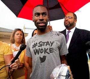 In this July 10, 2016, file photo, Black Lives Matter activist DeRay Mckesson talks to the media after his release from the Baton Rouge jail in Baton Rouge, La. (AP Photo/Max Becherer, File)
