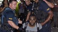 La. officer sues Black Lives Matter activist over protest injury