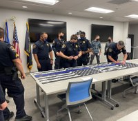 Hundreds of LEOs sign flags for LA deputies shot in ambush