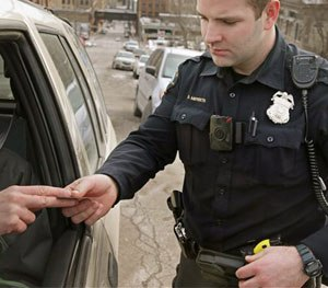 PERF believes that requiring officers to record every encounter with the public would undermine community members' privacy rights and damage important relationships with them. (AP Image)