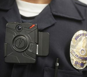 In this Jan. 15, 2014, file photo a Los Angeles Police officer wears an on-body camera during a demonstration in Los Angeles. (AP File Photo/Damian Dovarganes)